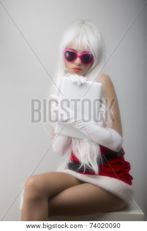 Blonde girl in pink glasses  soft effect