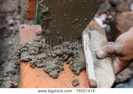 Bricklayer. Construction Worker Using Tools To Build A Brick Wall