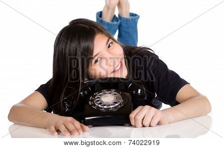 Young Girl Lying By Old Phone