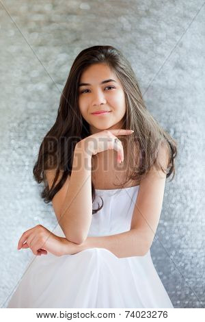 Beautiful Biracial Teen Girl In White Dress Sitting, Thinking