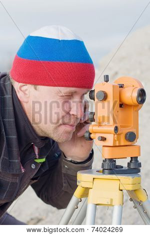 Engineer At The Construction Site Makes Measurements With Leveling