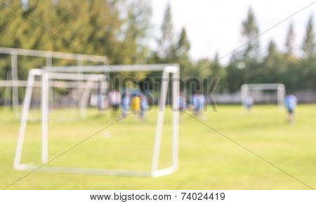 Blur Shot Of Soccer Field At School On Day Time Image.