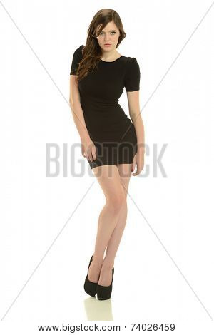 Gorgeous young woman wearing a black dress isolated on a white background