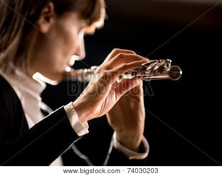 Female Flutist Performing