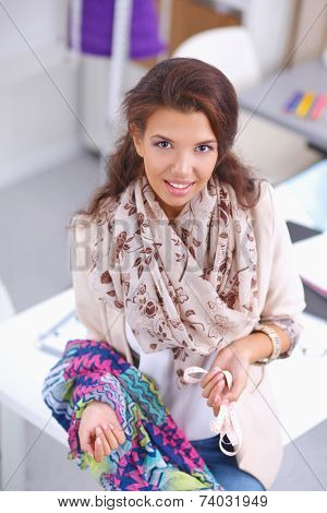 Portrait of beautiful female fashion designer working