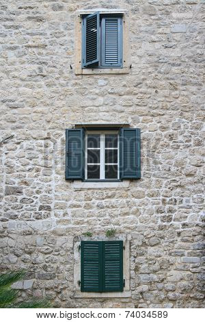 Windows With Shutters In The Three Storey Building