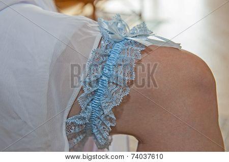 Closeup Of Brides Blue Garter