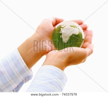 Hands holding a green earth, isolated on white background.