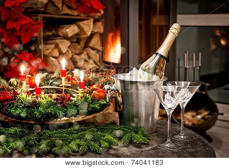Christmas Decoration. Bottle Of Champagne, Glasses And Fireplace