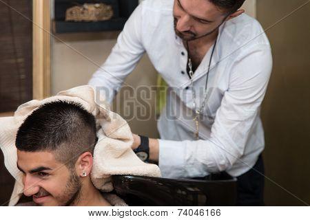 Smiling Man Having His Hair Washed At Hairdresser's