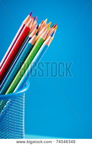 Colorful Pencils In Blue Basket Holder