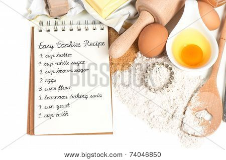 Recipe Book And Baking Ingredients Eggs, Flour, Sugar, Butter, Yeast