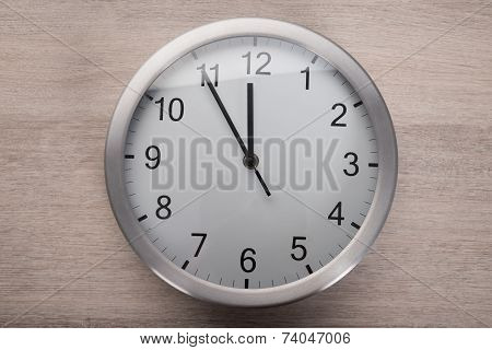 Clock Showing Five Before Noon