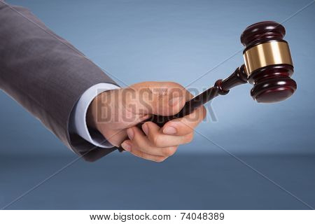 Hand Holding Judge Mallet