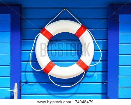 White Flotation Ring On The Blue Wall