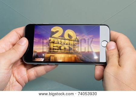 Hands Holding Apple Iphone6 With Logo Of Twentieth Century Fox