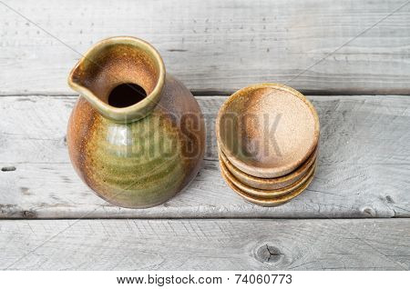 Japanese traditional sake cup and bottle on a wooden table