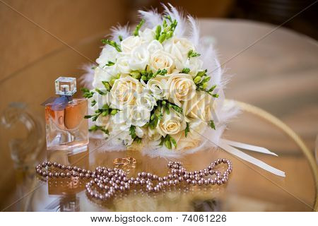 Wedding Accessories. The Bride's Bouquet, Pearls, Perfumes And Wedding Rings.