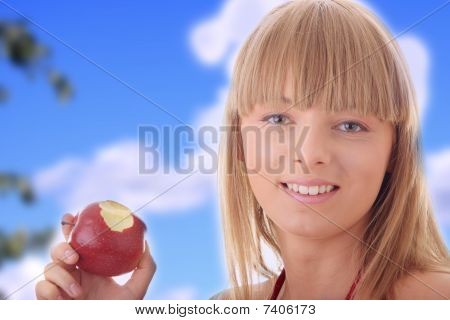 Young Blond Woman With Red Apple