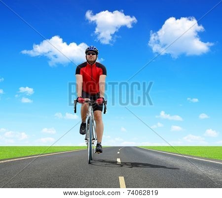 Cyclist riding on a road bike