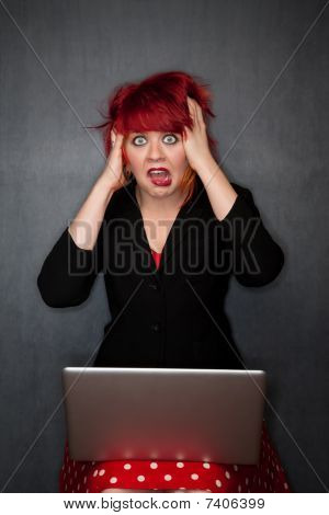 Punky Girl With Red Hair With Laptop Computer