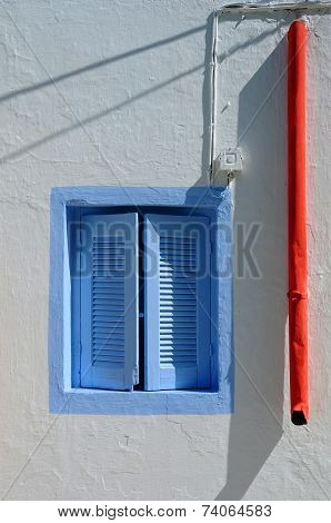Blue Window And Red Rainwater Pipe
