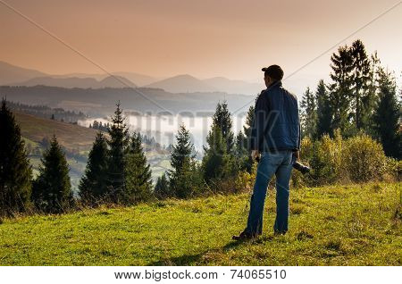 Man Photographer In The Mountains.