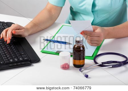 Doctor's Hands Checking Rx Paper
