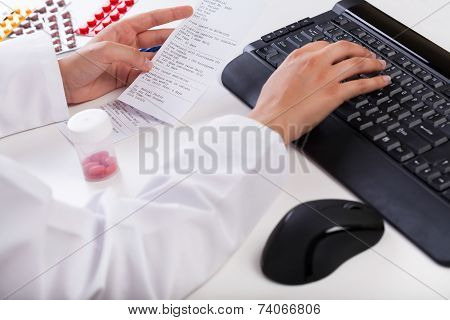 Pharmacist Realizing Rx Paper