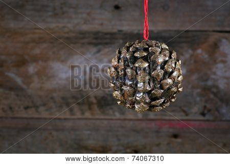 Ball Shape Pine Cone Christmas Decoration On Old Rustic Background