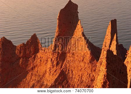 shapes and land mass on sea shore