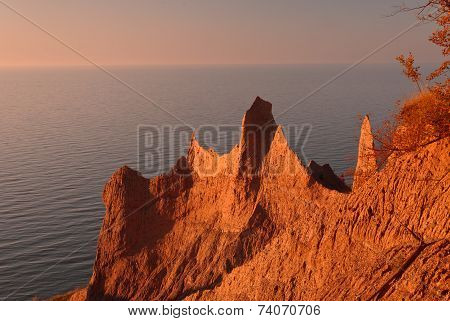sunset on exotic land formation sea-side