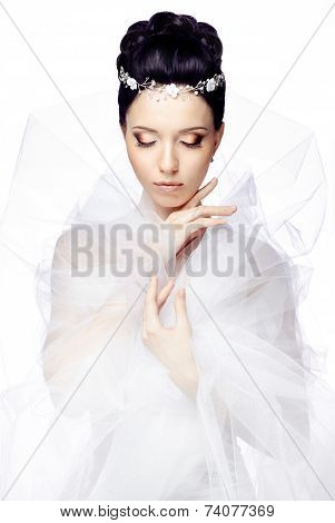 woman with closed eyes isolated on white studio background dressed in the cape of organza and