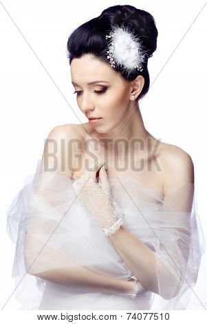 Modest young woman isolated on white studio background dressed in the cape of organza and lace glove