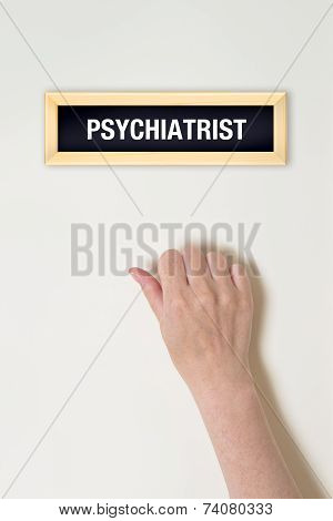 Female Hand Is Knocking On Psychiatrist Door
