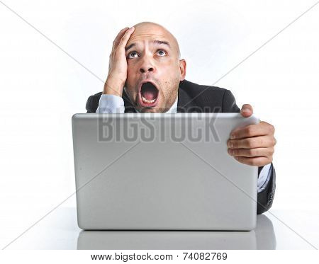 Hispanic Businessman In Stress At Laptop Holding Monitor Screaming Desperate