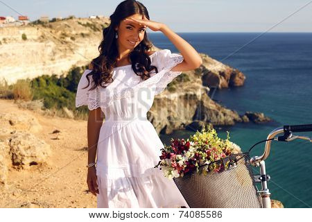Pretty Smiling Girl Riding A Bicycle Along The Sea Coast