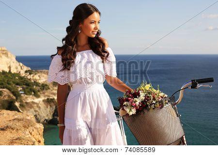 Beautiful Smiling Girl Riding A Bicycle Along The Sea Coast