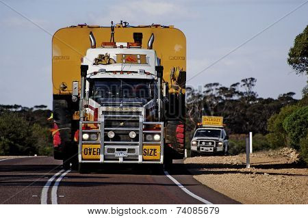 Pilot Car Following A Huge Australian Truck