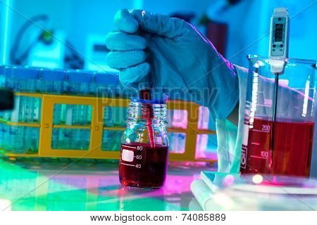 Researchers Work In Modern Scientific Lab. Preparation Of Hazardous Solution