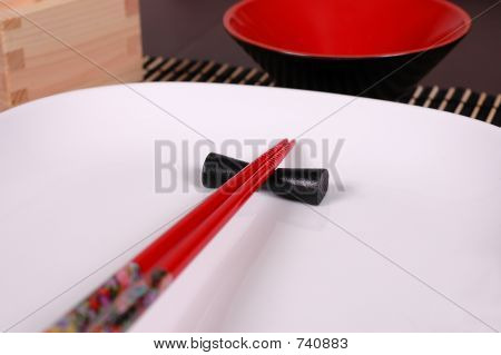 Chopsticks on white plate