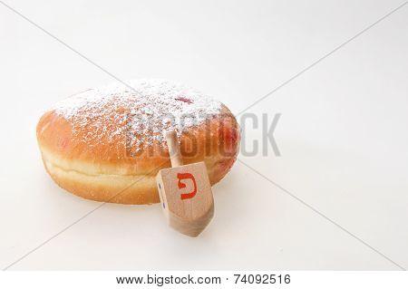Hanukkah doughnut and spinning top