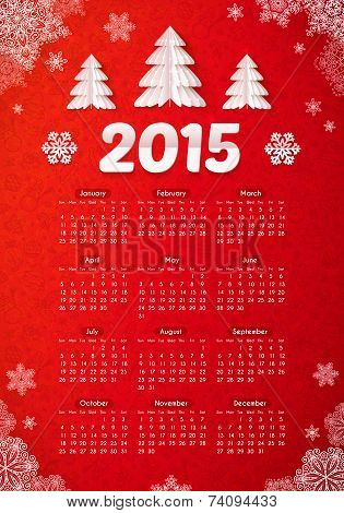 Red 2015 new year calendar with paper Christmas trees