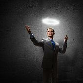 stock photo of halo  - Young handsome businessman with halo above head - JPG