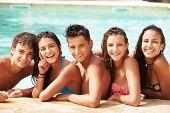 image of 15 year old  - Portrait Of Teenage Friends Having Fun In Swimming Pool - JPG