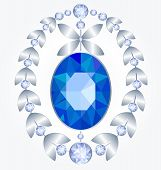 stock photo of brooch  - Brooch with a large sapphire and silver leaves with diamonds - JPG