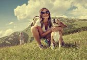 stock photo of dog-walker  - Woman with beagle dog on mountain hill - JPG