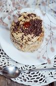 stock photo of patty-cake  - One little cake with cream jam and chocolate sprinkles for dessert - JPG