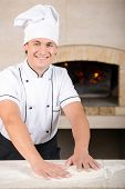 picture of pastry chef  - Chef preparing pastry in his kitchen - JPG