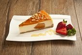 picture of cheesecake  - pumpkin cheesecake with strawberry concept stock image - JPG